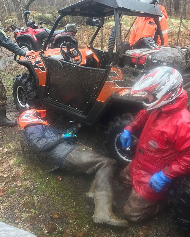 @tomdrich assessing the damage to the #rzr skid plates. @chriscross4653 never misses an opportunity to get down on his knees. #swampdonkeys #broken #rzr